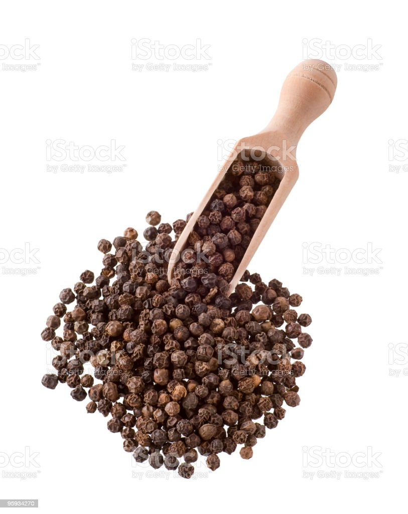 Close-up of a handful of whole peppercorns stock photo