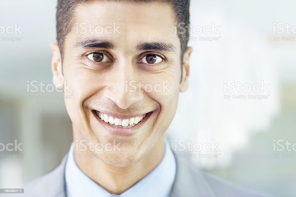 Closeup of a handsome business man smiling royalty-free stock photo