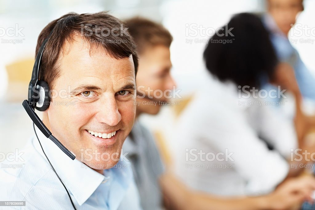 Closeup of a handsome customer care representative at work royalty-free stock photo
