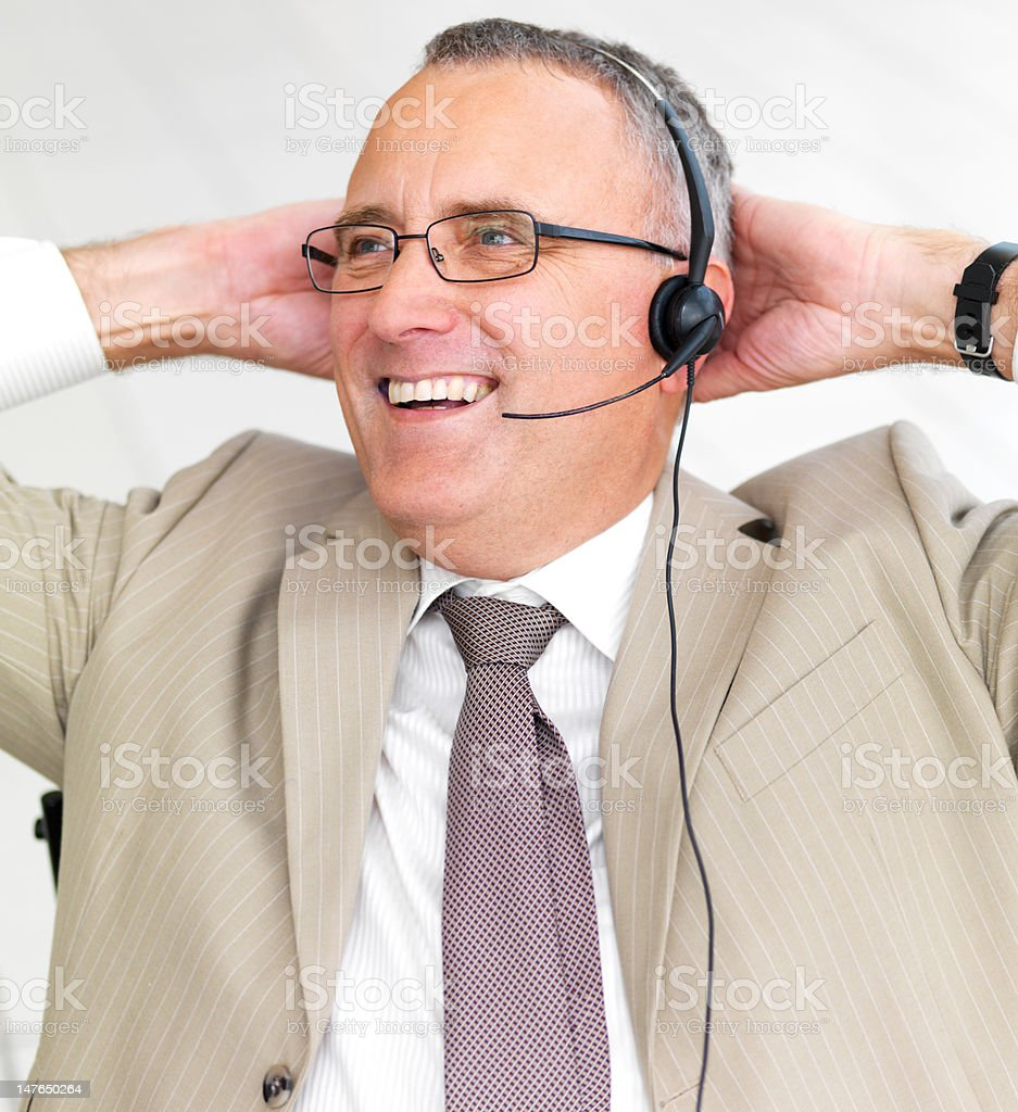 Close-up of a happy businessman talking on the phone royalty-free stock photo