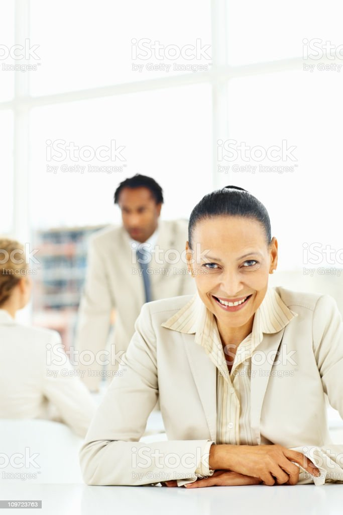 Close-up of a happy businesswoman with colleague at background royalty-free stock photo