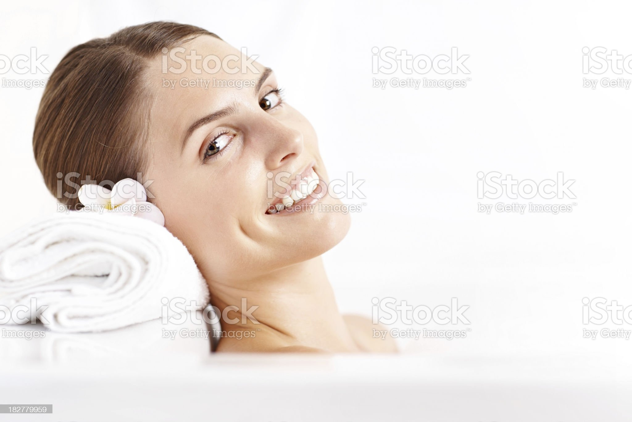 Close-up of a happy female relaxing in bath tub royalty-free stock photo