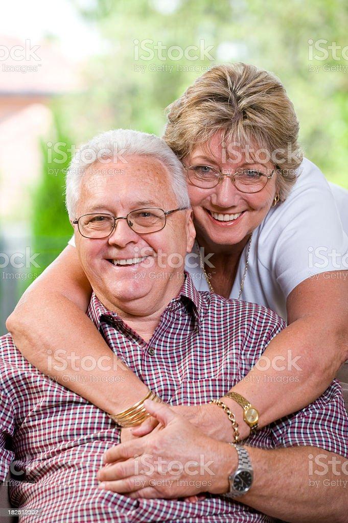 Close-up of a happy senior couple having fun hugging royalty-free stock photo