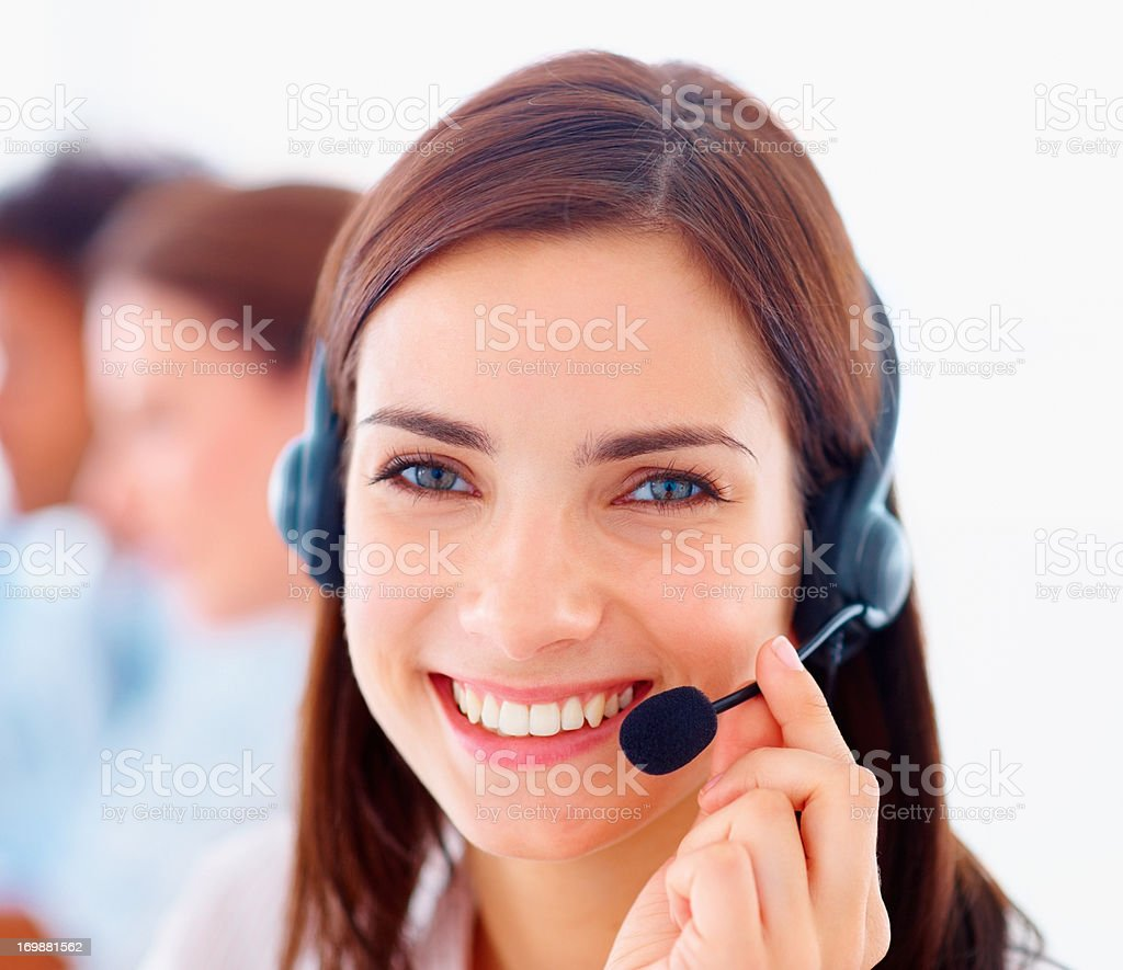 Closeup of a happy young customer representative wearing headset stock photo