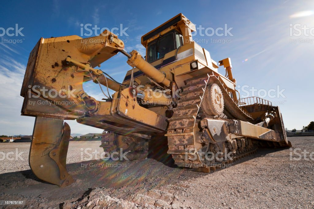 Close-up of a heavy equipment bulldozer covered in mud stock photo