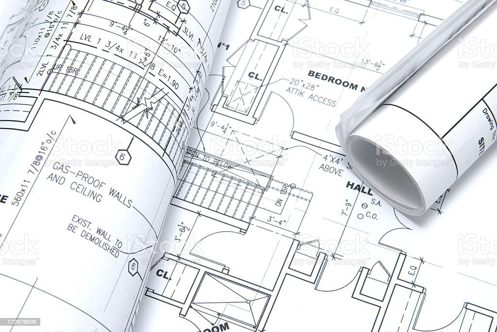 Close-up of a house blueprint and a rolled blueprint royalty-free stock photo