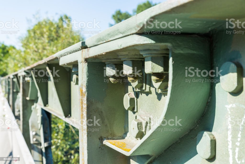 Close-up of a iron bridge with screw and rivet stock photo