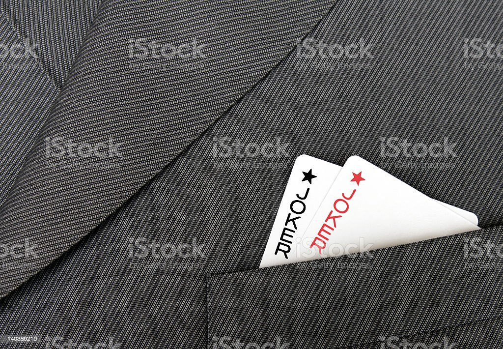 Close-up of a jacket with two joker cards in the pocket stock photo