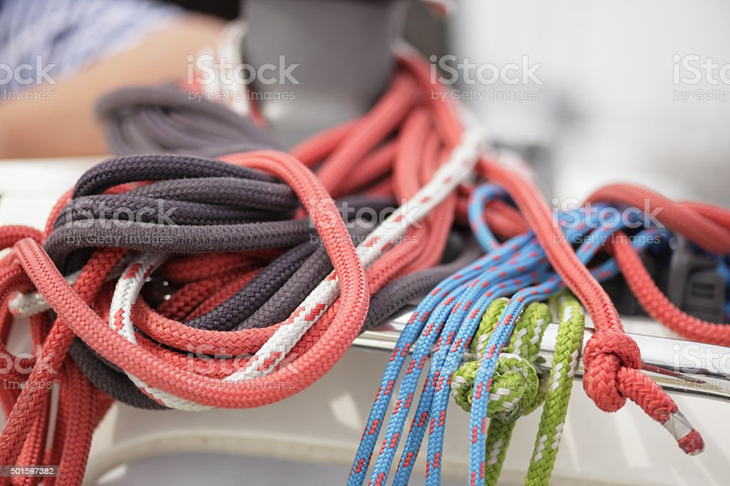 Closeup of a knotted rope on a sail boat. stock photo