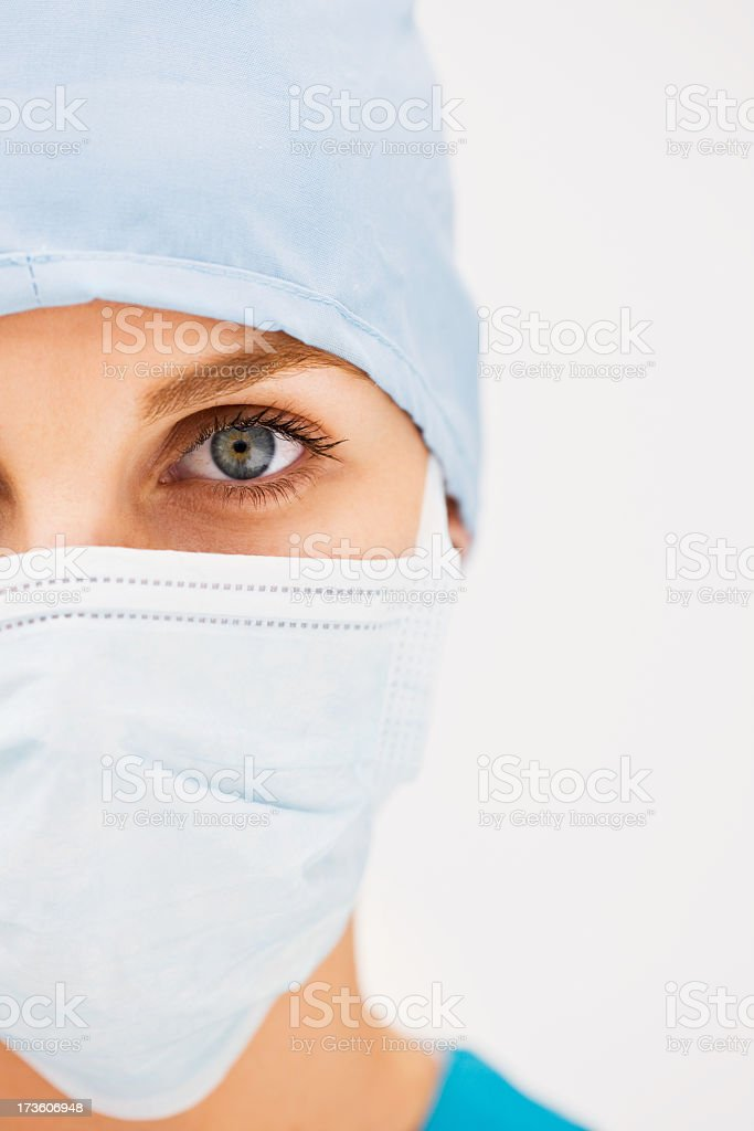 Closeup of a lady wearing surgical mask royalty-free stock photo