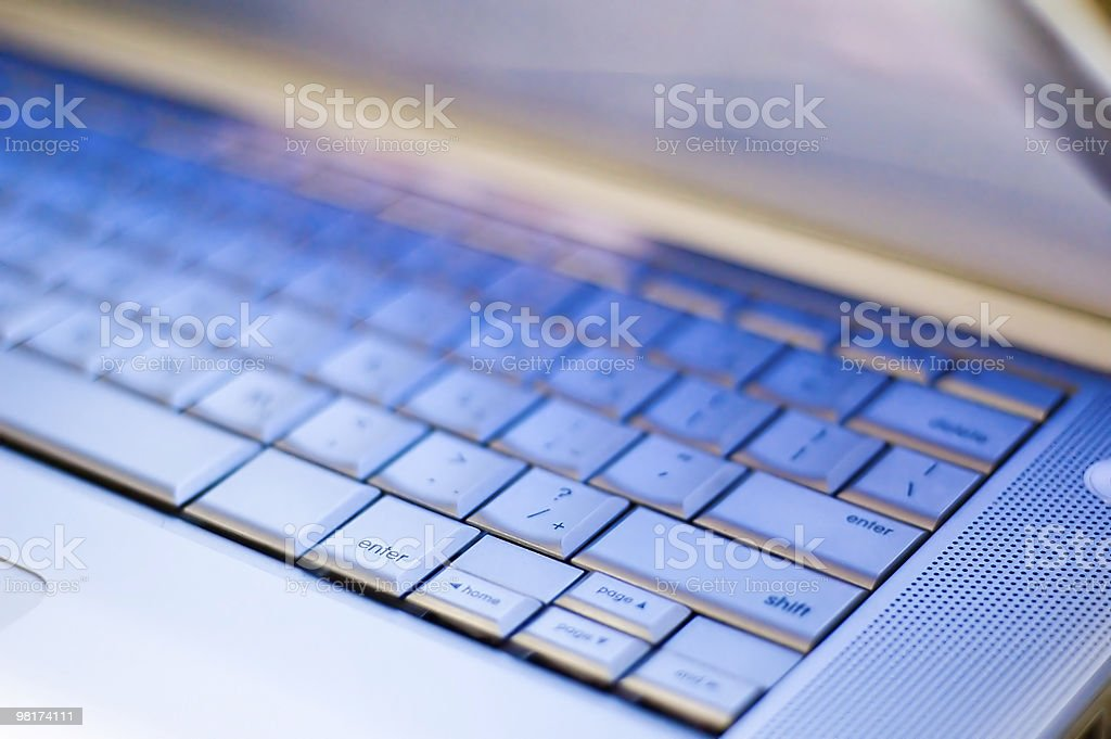 Closeup of a laptop keyboard being lit by the screen royalty-free stock photo