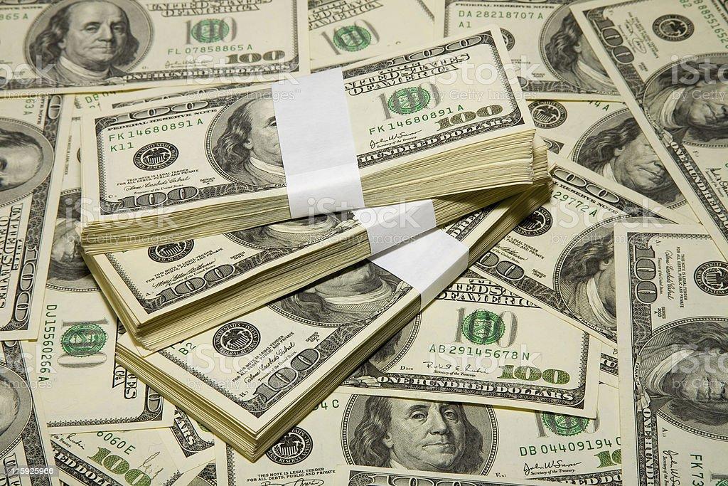 Closeup of a large pile of bundles containing US $100 bills stock photo