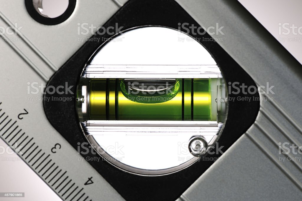 Close-up of a level against spotlight background stock photo