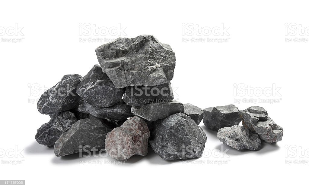 Closeup of a limestone chippings on white background stock photo