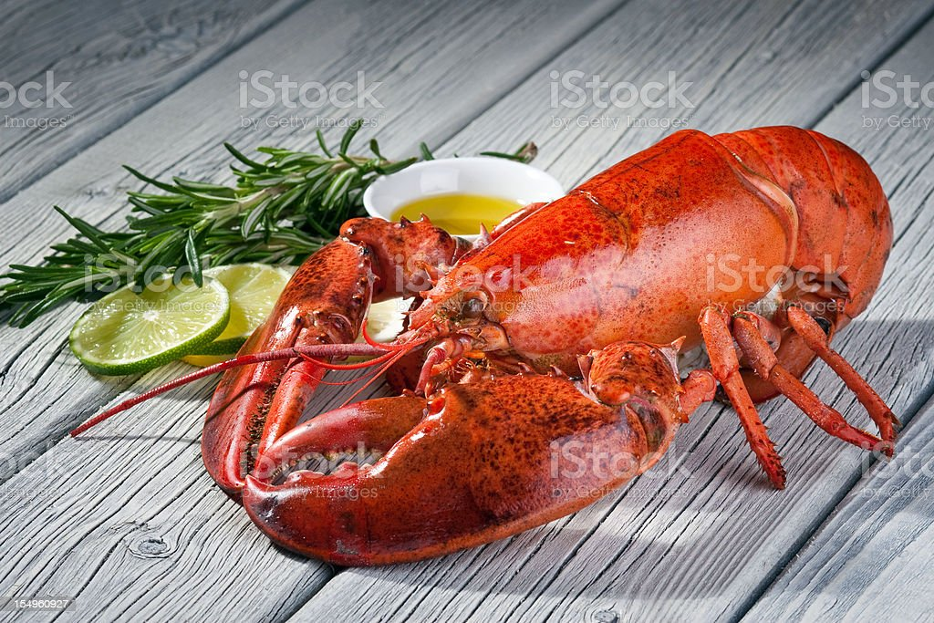 Close-up of a lobster on a wood table stock photo