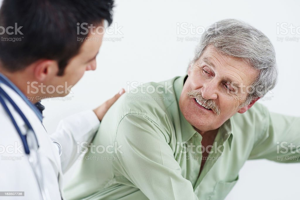 Closeup of a male doctor comforting senior patient royalty-free stock photo