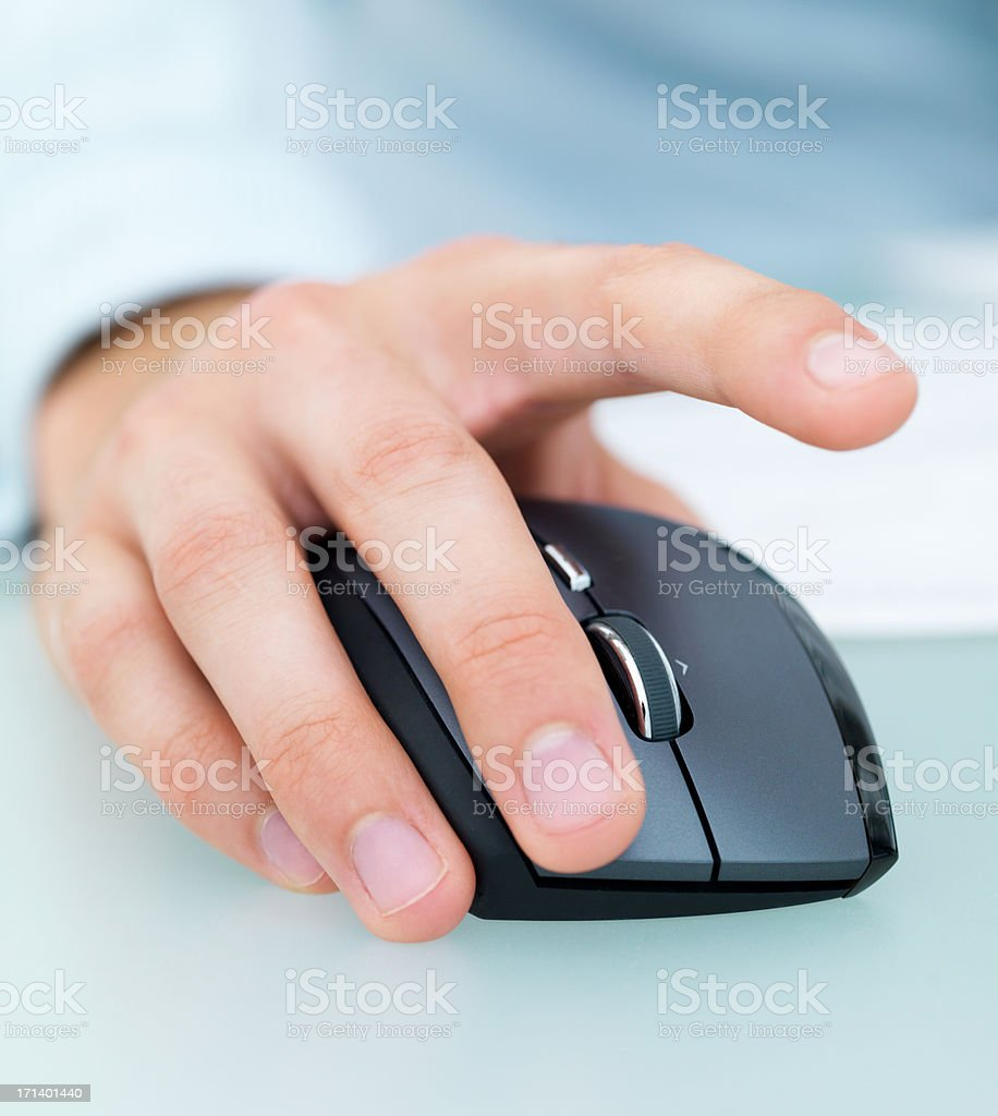 Closeup of a male's hand working on a computer mouse royalty-free stock photo