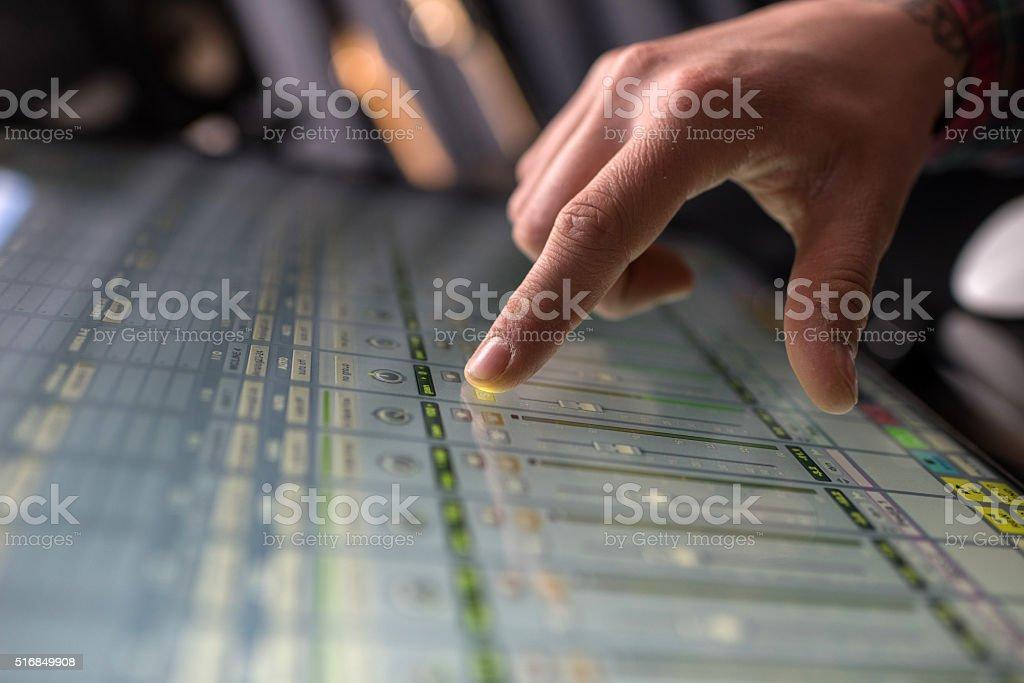 Close-up of a man adjusting sound on digital sound mixer. stock photo