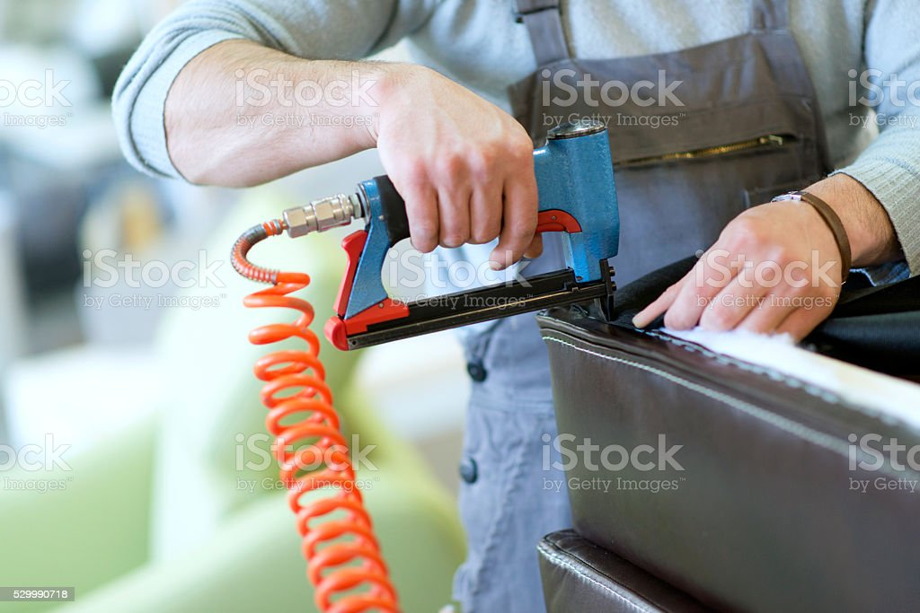 Close-up of a Man at Work how Upholstering Furniture stock photo