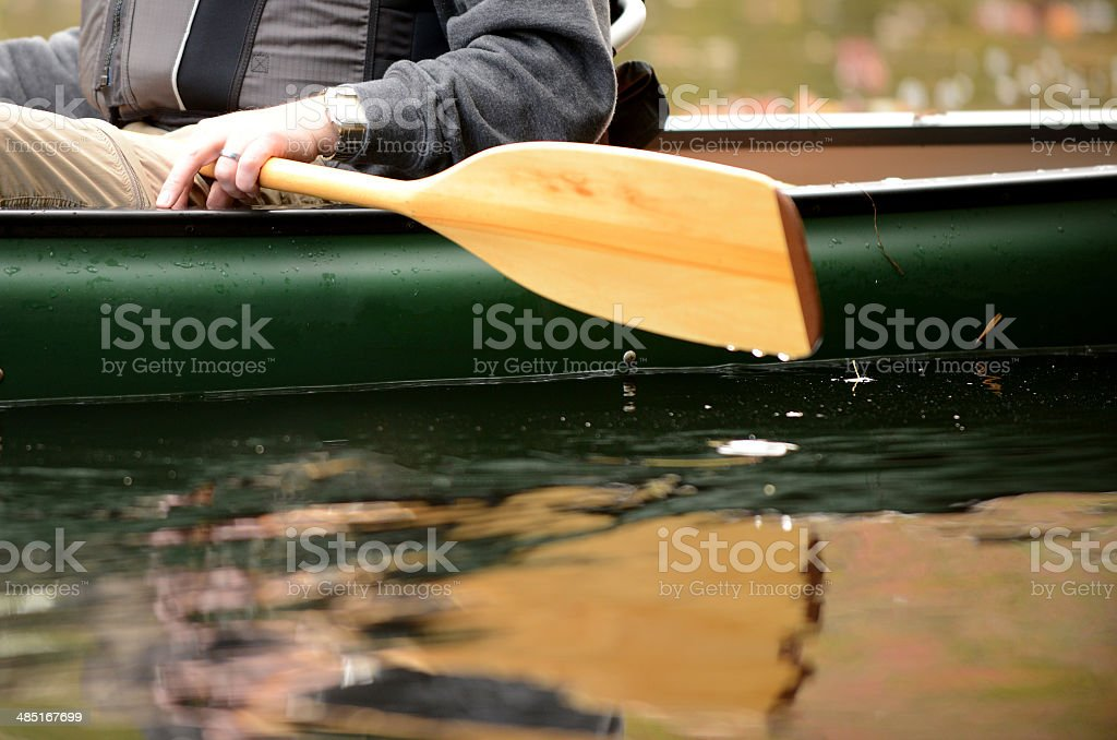 close-up of a man in a canoe stock photo
