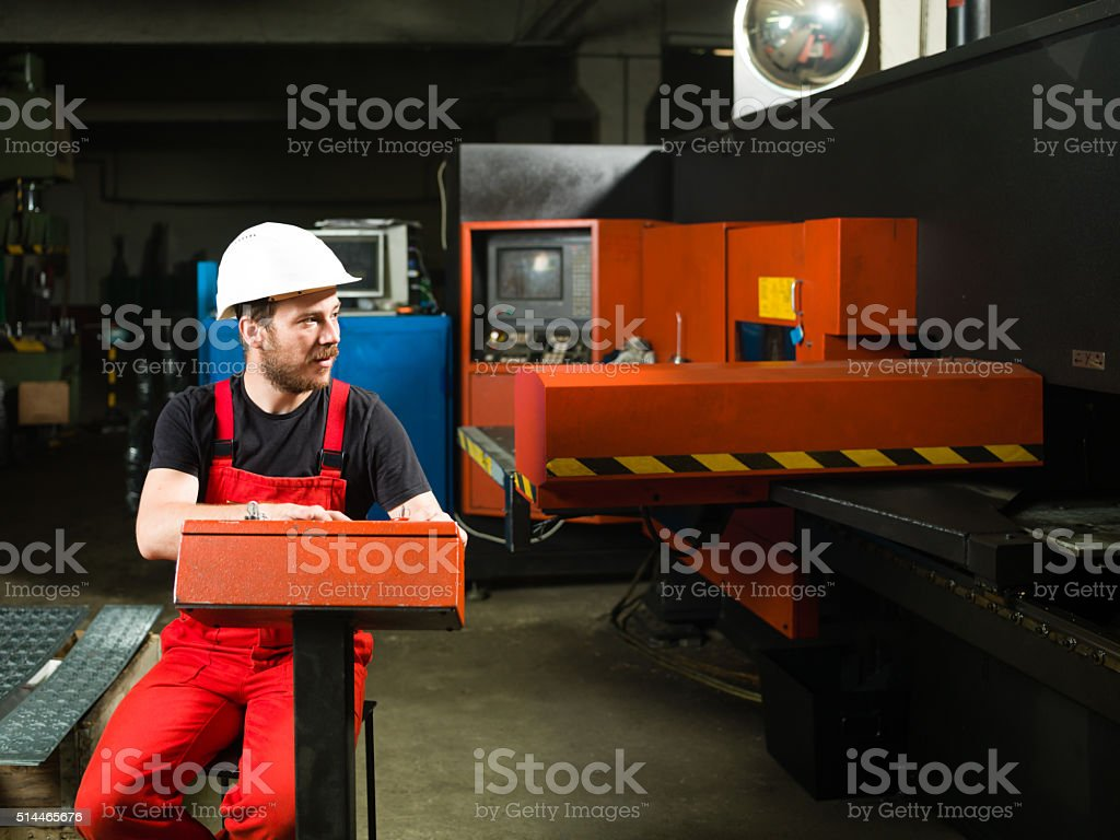close-up of a man in red overalls stock photo