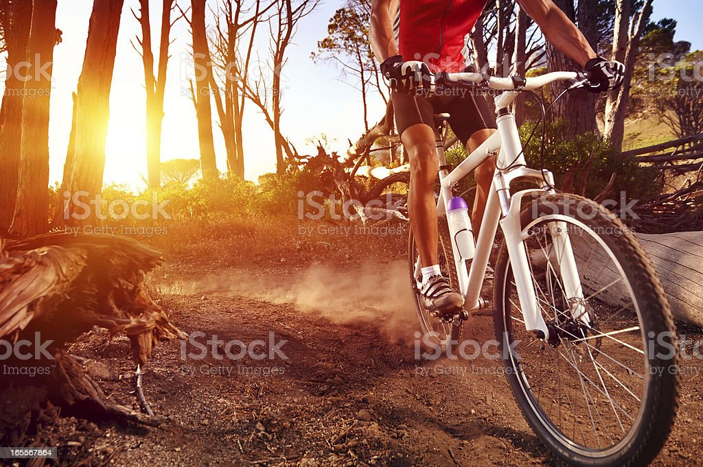 Close-up of a man on mountain bike riding on trail stock photo