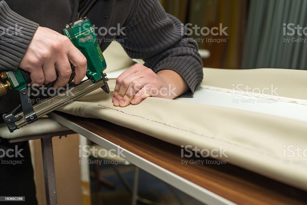 Close-up of a man upholstering furniture royalty-free stock photo