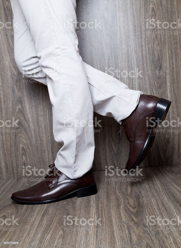 Close-up of a man wearing brown leather dress shoes stock photo