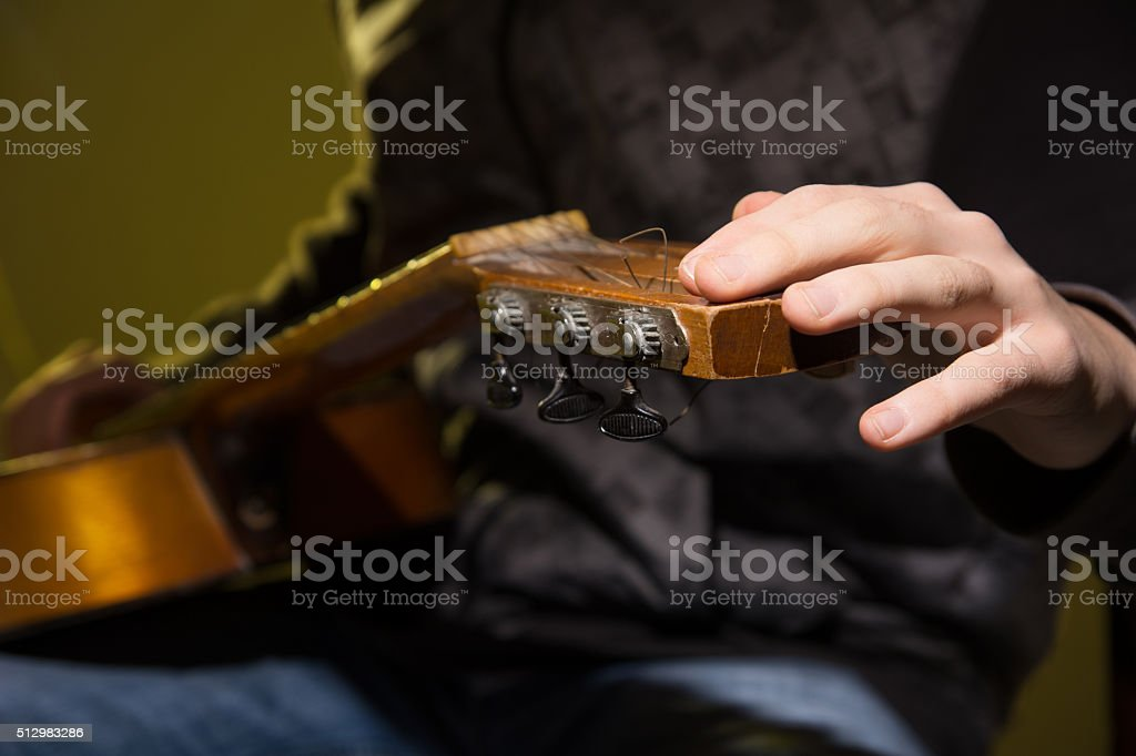 Close-up of a man with guitar. stock photo