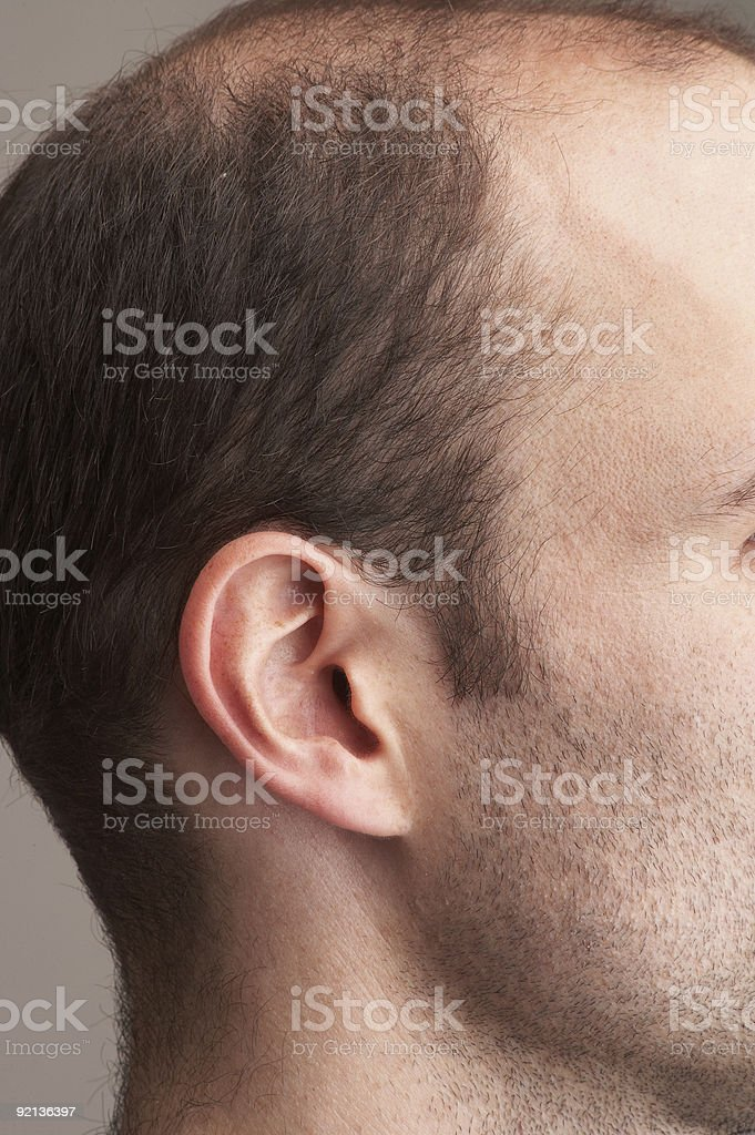 Closeup of a man's ear stock photo