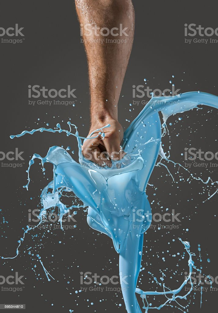Close-up of a man's fist punching through liquid stock photo