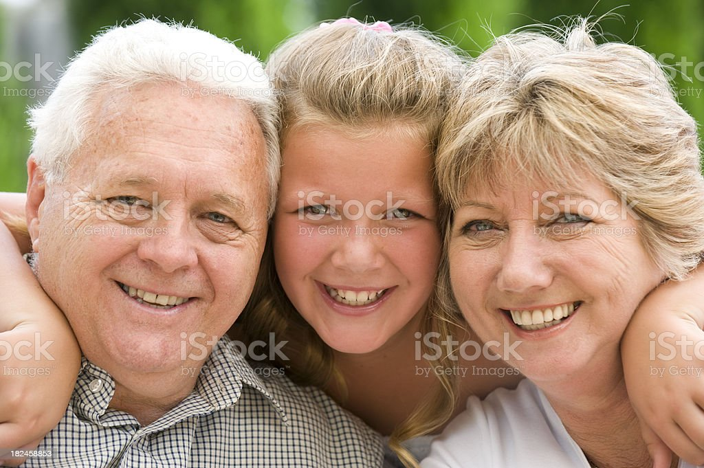 Close-up of a mature couple with their granddaughter royalty-free stock photo
