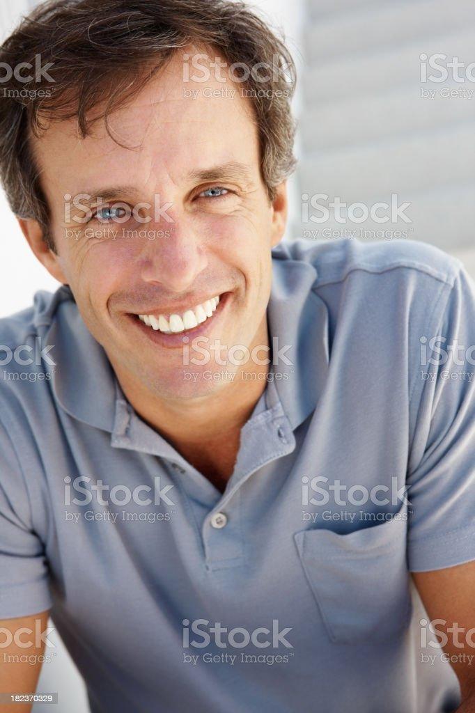 Closeup of a mature man smiling royalty-free stock photo