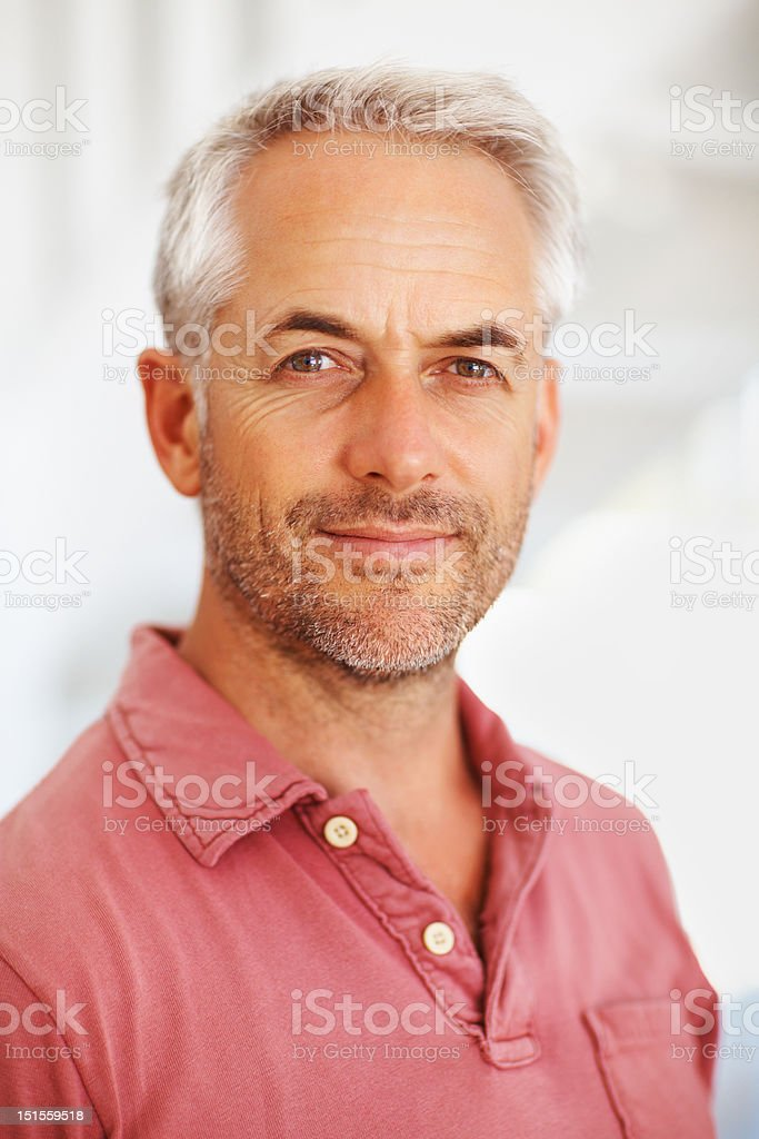 Close-up of a mature man smirking stock photo