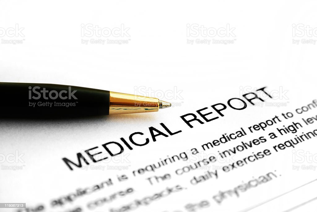 Close-up of a medical report with a pen on top royalty-free stock photo