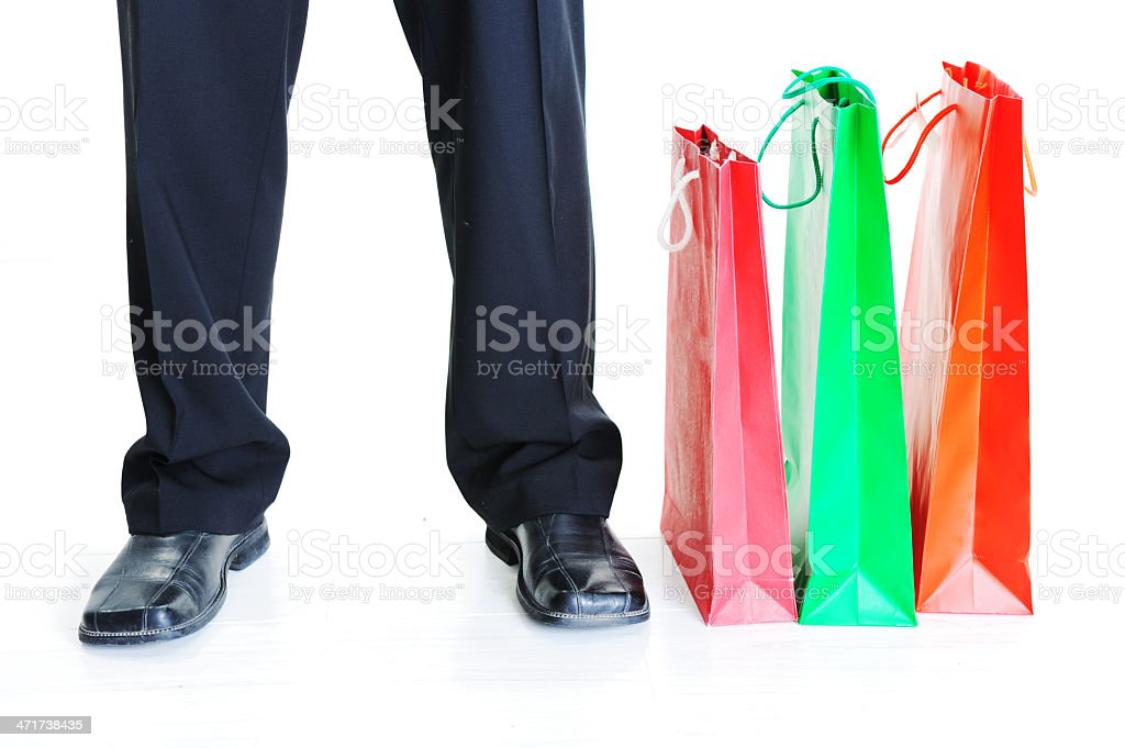 Closeup of a men`s legs standing beside shopping bags royalty-free stock photo