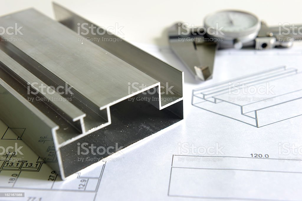 A close-up of a metal piece and drawings royalty-free stock photo