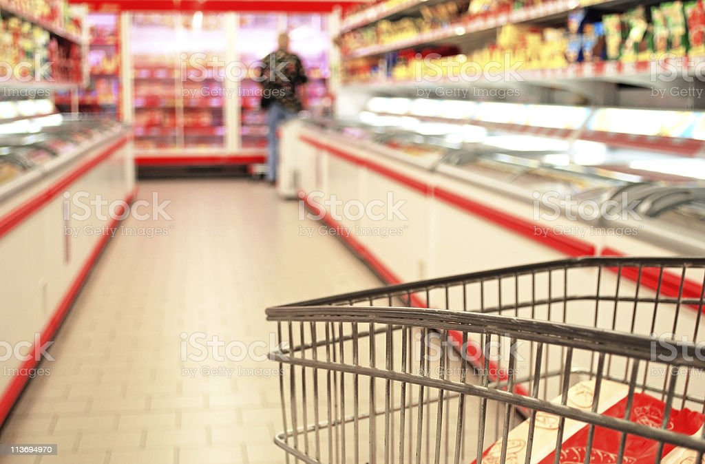 A close-up of a metal shopping cart at a supermarket royalty-free stock photo