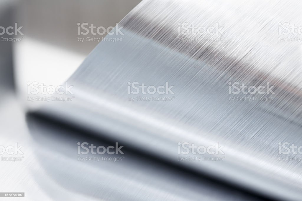 Close-up of a metallic sheet that is rolled up stock photo