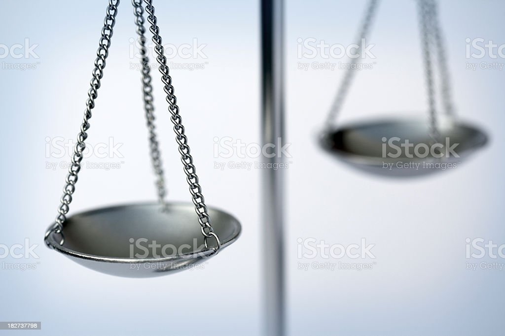 Close-up of a metallic weighing scale focused on one plate royalty-free stock photo