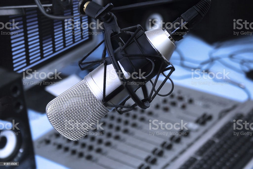 A close-up of a microphone in a radio studio stock photo