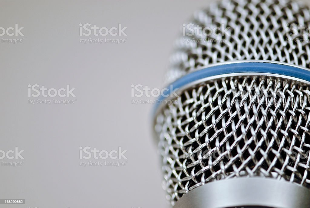 Close-up of a microphone on gray background royalty-free stock photo
