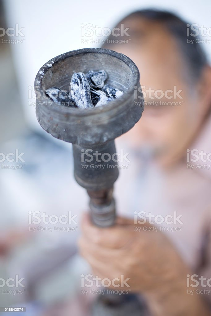 Close-up of a mid adult man smoking hookah stock photo
