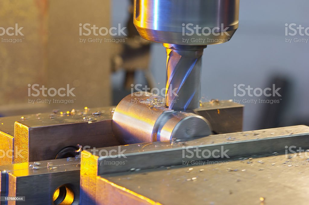 Close-up of a milling machine cutting into metal stock photo