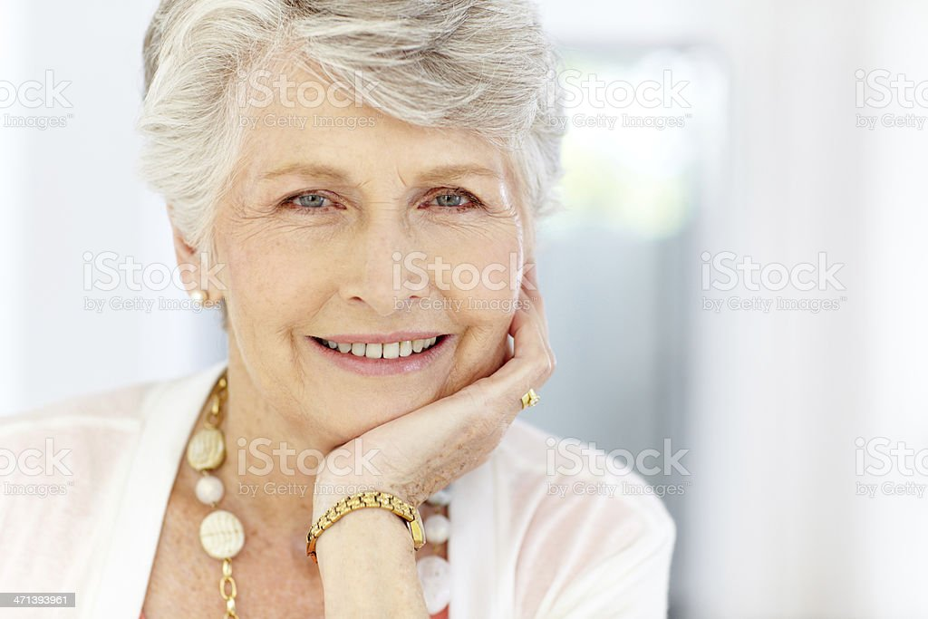 Closeup of a modern successful senior woman stock photo