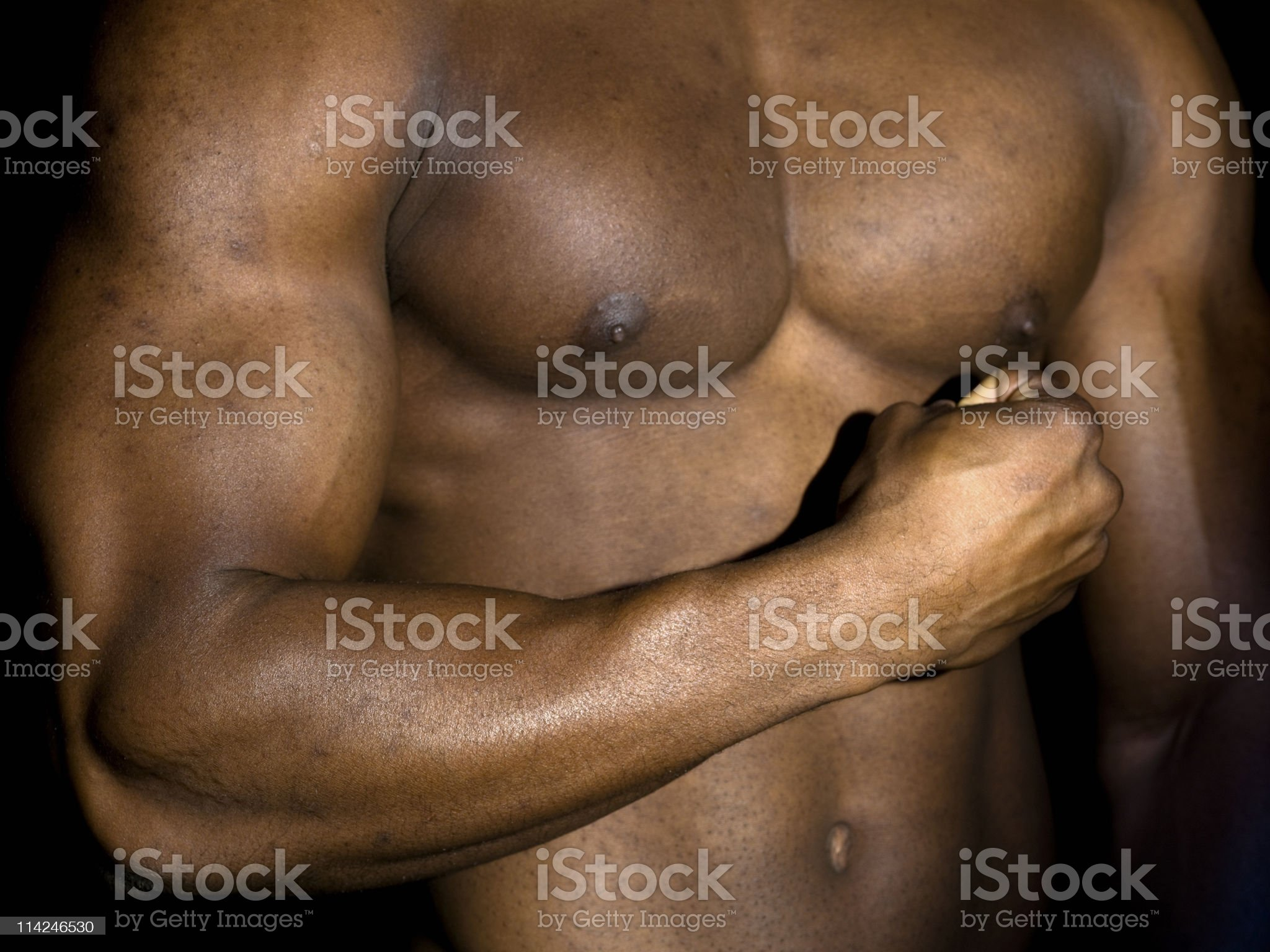 Close-up of a muscular built chest royalty-free stock photo