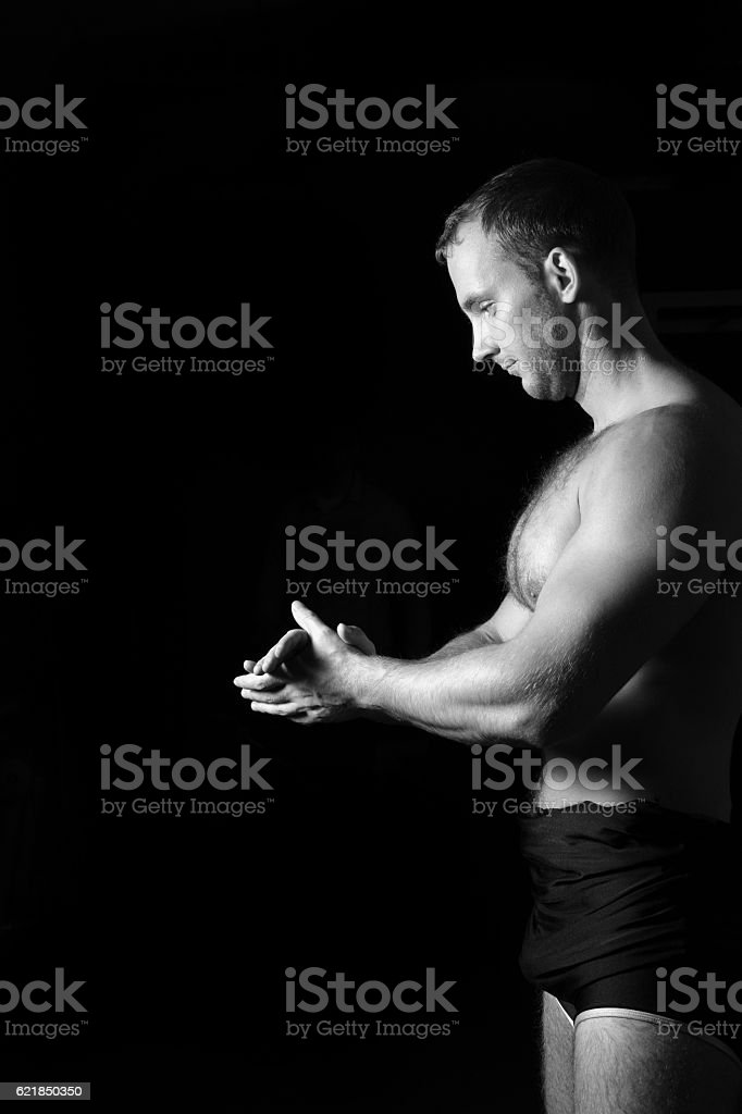 Closeup of a muscular man ready to workout. stock photo