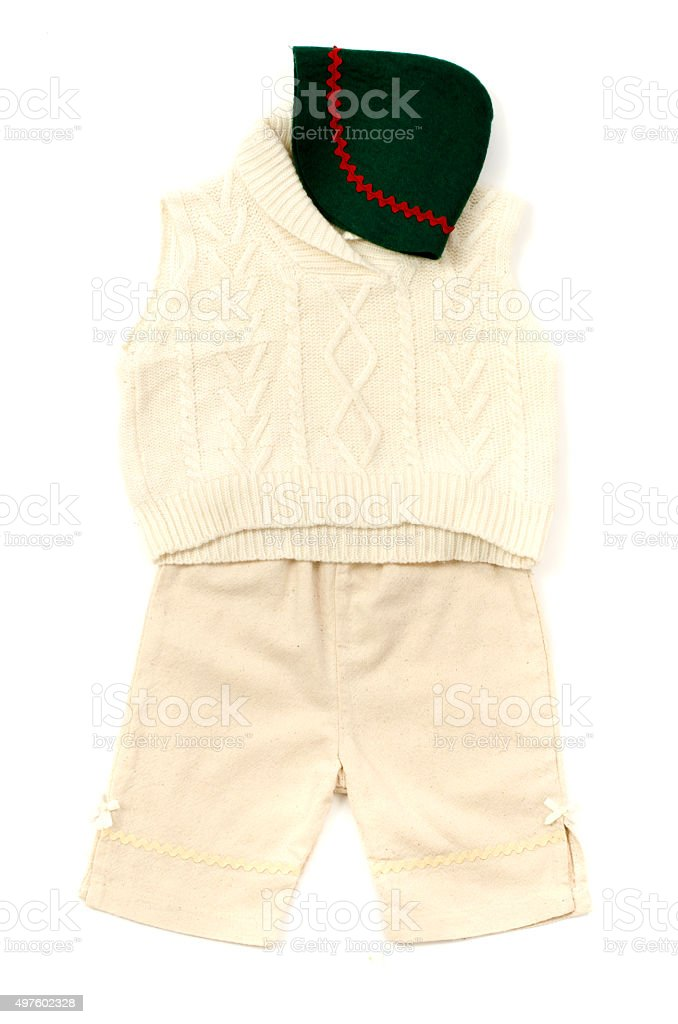 Closeup of a newborn green hat and infant winter outfit. stock photo