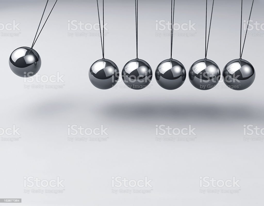Close-up of a Newton's cradle with the left hand ball out stock photo