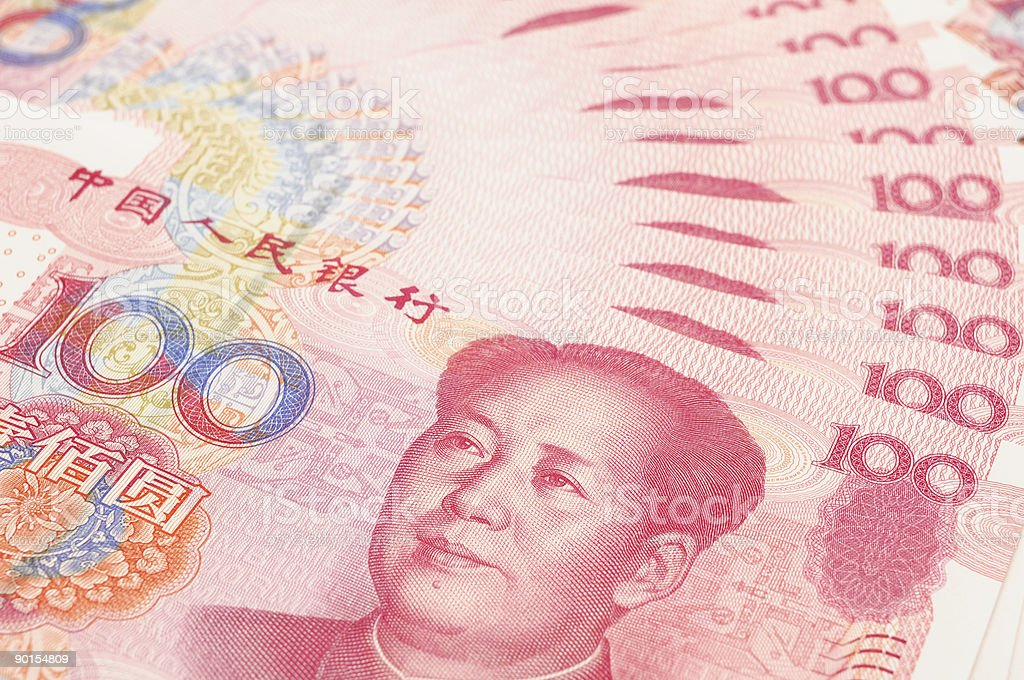 Close-up of a number of pink China yuan currency stock photo